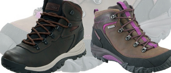 Hiking boots with compass on tree trunk at campsite